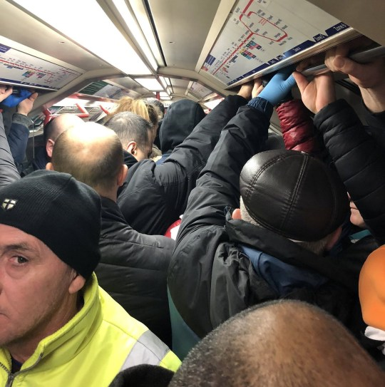 A cramped tube on the Circle linethis morning 24 March 2020. See SWNS story SWTPbusy These staggering photos show busy trains packed full of commuters - AFTER draconian 'lockdown' measures were introduced. People were snapped travelling as early as 5am - just hours after Boris Johnson stressed that all but key workers should stay at home. One person took photos of their early morning journey to London from Milton Keynes both yesterday (Mon) and today (Tues). Both pictures show crammed trains with many passengers wearing masks - and touching communal poles. Another commuter captured the sight of a crowd of passengers waiting on a very full platform at a station in Leytonston, East London this morning. They took a second photograph from inside the cramped tube on the Circle line - showing passengers forced to stand very close together.
