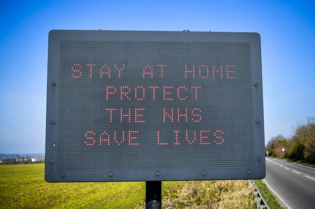 A matrix road sign on the A367 into Bath advises motorists to stay at home to protect the NHS and save lives