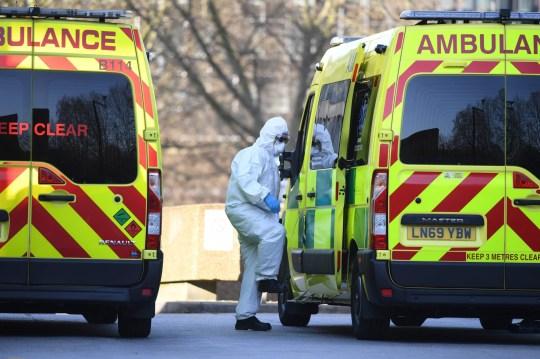 An ambulance worker stepping into an ambulance
