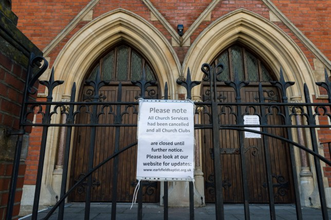 LONDON, UNITED KINGDOM - MARCH 24, 2020: A sign notifying of cancellation of church services on the church gate in Earlsfield, south-west London as the UK enters the first day of lockdown to try to slow the spread of the Coronavirus on 24 March, 2020 in London, England. Last night, British Prime Minister Boris Johnson announced a complete lockdown of the UK for at least three weeks, banning people from leaving their homes, except for a few specific reasons, or meeting in groups of more than two people with all non-essential shops and businesses also required to close.- PHOTOGRAPH BY Wiktor Szymanowicz / Barcroft Studios / Future Publishing (Photo credit should read Wiktor Szymanowicz/Barcroft Media via Getty Images)
