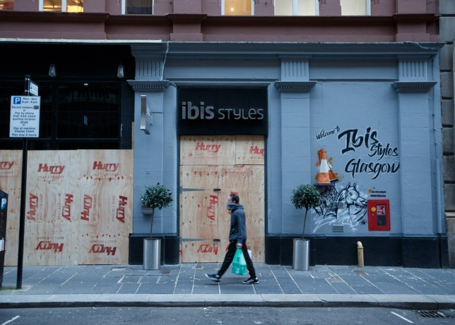 epa08319720 Shop fronts boarded up during the lockdown in Glasgow, Britain, 24 March 2020. Countries around the world are taking increased measures to stem the widespread of the SARS-CoV-2 coronavirus which causes the Covid-19 disease. EPA/Robert Perry