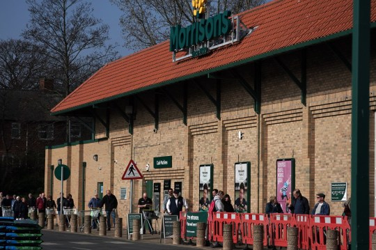 Customers social distancing in the queue outside Morrisons supermarket in Whitley Bay, Tyne and Wear, after Prime Minister Boris Johnson put the UK in lockdown to help curb the spread of the coronavirus. PA Photo. Picture date: Thursday March 26, 2020. The UK's coronavirus death toll reached 463 on Wednesday. See PA story HEALTH Coronavirus. Photo credit should read: Victoria Jones/PA Wire
