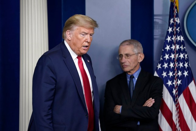 WASHINGTON, DC - MARCH 26: U.S. President Donald Trump arrives as National Institute of Allergy and Infectious Diseases Director Anthony Fauci waits for the beginning of a briefing on the coronavirus pandemic in the press briefing room of the White House on March 26, 2020 in Washington, DC. The U.S. House of Representatives is scheduled to vote Friday on the $2 trillion stimulus package to combat the effects of the COVID-19 pandemic. (Photo by Drew Angerer/Getty Images)