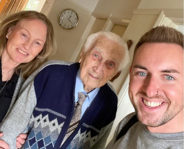 Tesco workers Dan, right, and Carole, far left, with 99-year-old Norman, who found he could only buy a comb from his shopping list after coronavirus panic-buyers cleared the shelves at his local Tesco supermarket