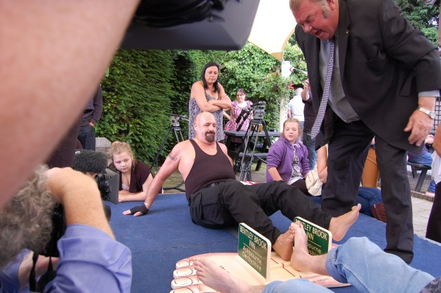 Alan competing at toe wrestling