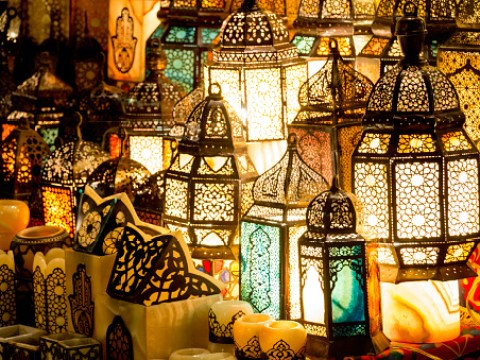 What does 'Ramadan Mubarak' mean and what greetings wish someone a Happy Ramadan?