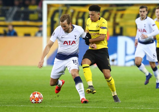 DORTMUND, GERMANY - MARCH 05: Harry Kane of Tottenham Hotspur and Jadon Malik Sancho of Borussia Dortmund  battle for the ball  during the UEFA Champions League Round of 16 Second Leg match between Borussia Dortmund and Tottenham Hotspur at Westfalen Stadium on March 5, 2019 in Dortmund, North Rhine-Westphalia. (Photo by TF-Images/Getty Images)