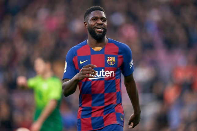 Samuel Umtiti smiles while in action for Barcelona