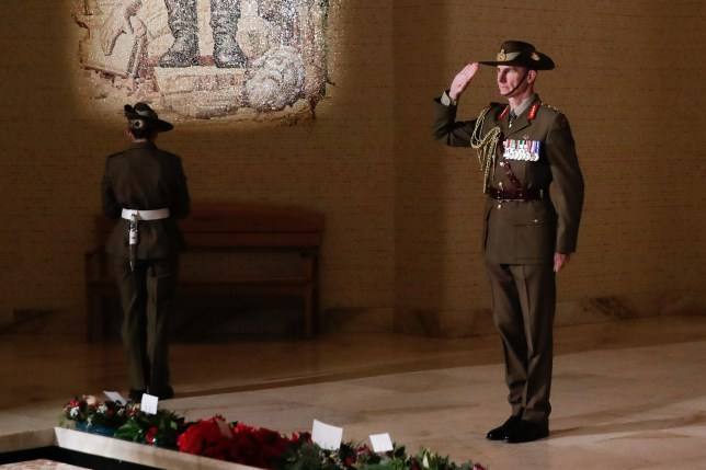 Chief of the Defence Force General Angus Campbell lays a wreath at the Tomb of the Unknown Australian Soldier during the Anzac Day commemorative service