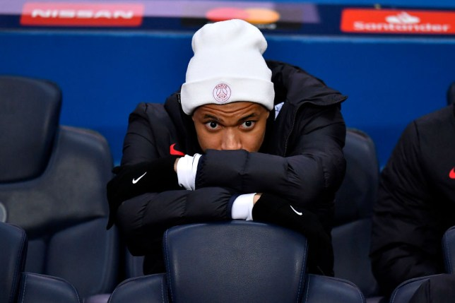 Kylian Mbappe sits on the bench for Paris Saint-Germain