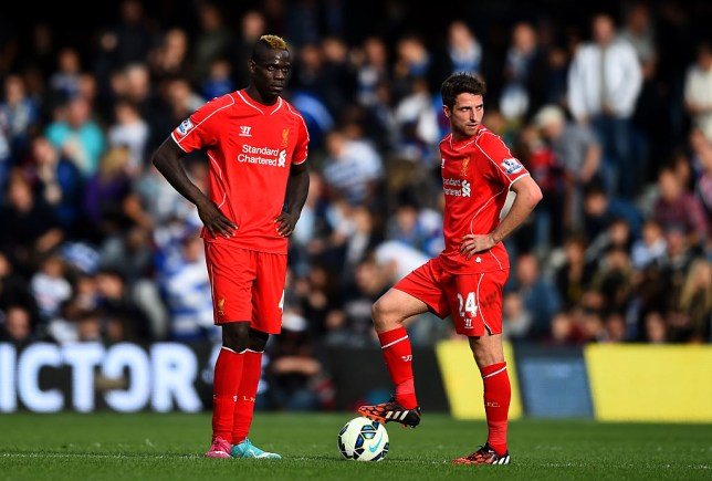 Mario Balotelli and Joe Allen of Liverpool wait to restart a Liverpool game