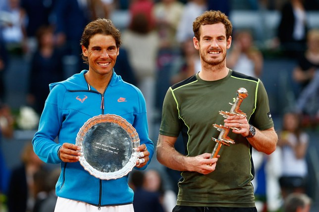 MADRID, SPAIN - MAY 10:  Andy Murray of Great Britain holds the winners trophy with runner up Rafael Nadal of Spain in the final during day nine of the Mutua Madrid Open tennis tournament at the Caja Magica on May 10, 2015 in Madrid, Spain.  (Photo by Julian Finney/Getty Images)