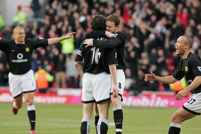 Roy Keane of Manchester United celebrates scoring with Wayne Rooney
