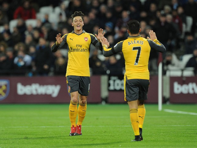 Mesut Ozil and Alexis Sanchez playing for Arsenal