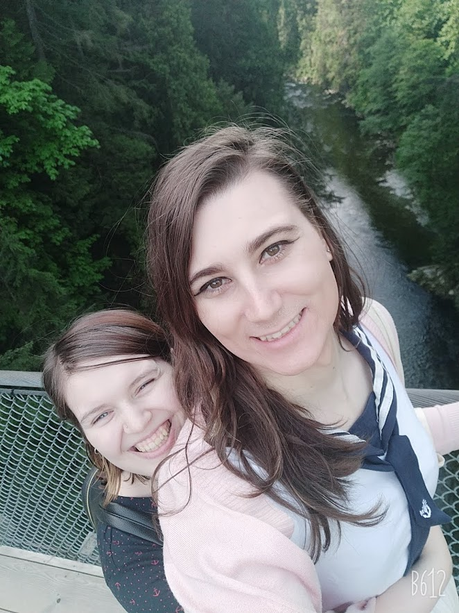 V and Marcy on a bridge overlooking a river