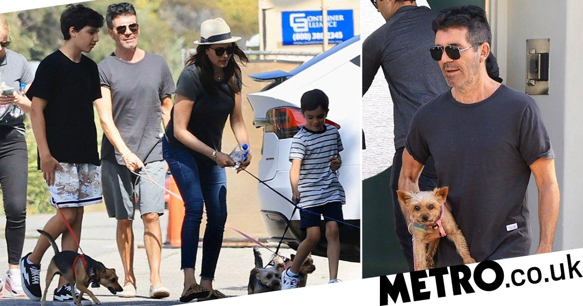 Simon Cowell, Lauren Silverman and their kids escape isolation to walk the dogs
