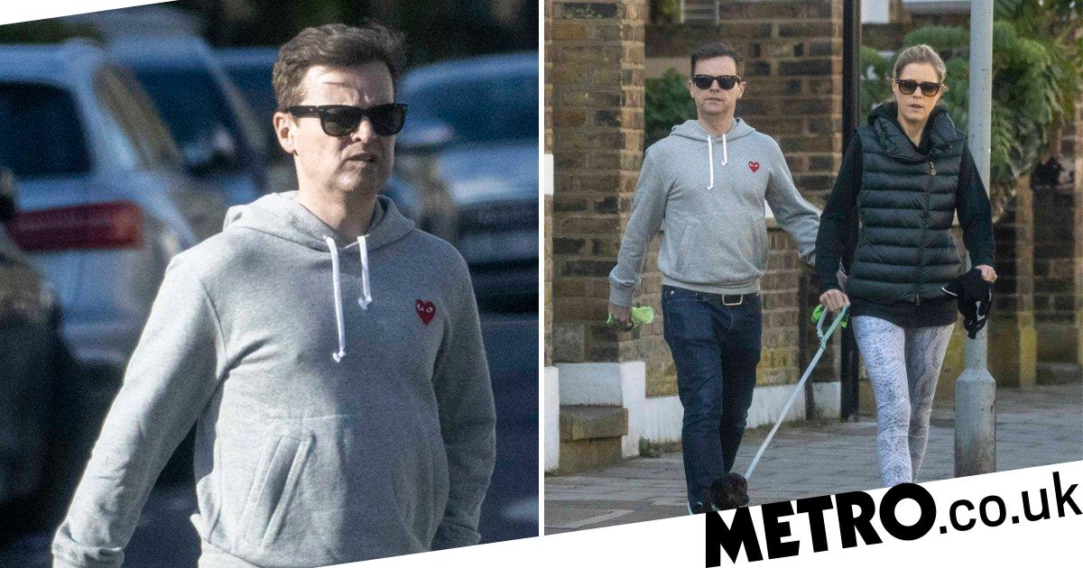 Declan Donnelly and wife Ali Astall get their daily exercise in with sausage dog