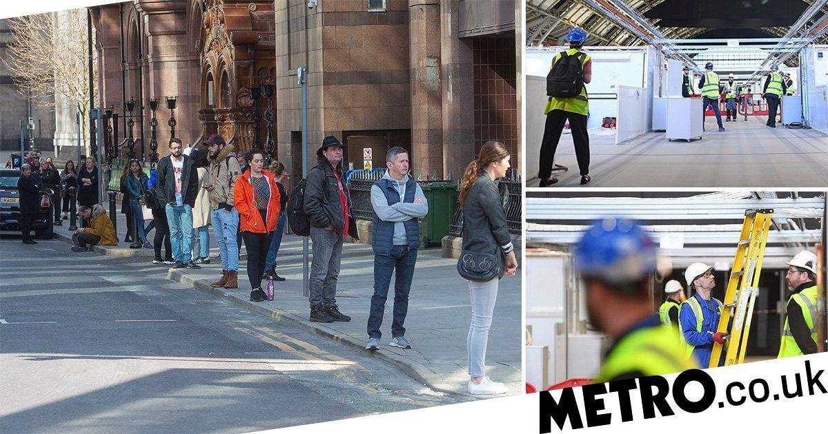 Volunteers queue around the block to help at new NHS Nightingale hospital