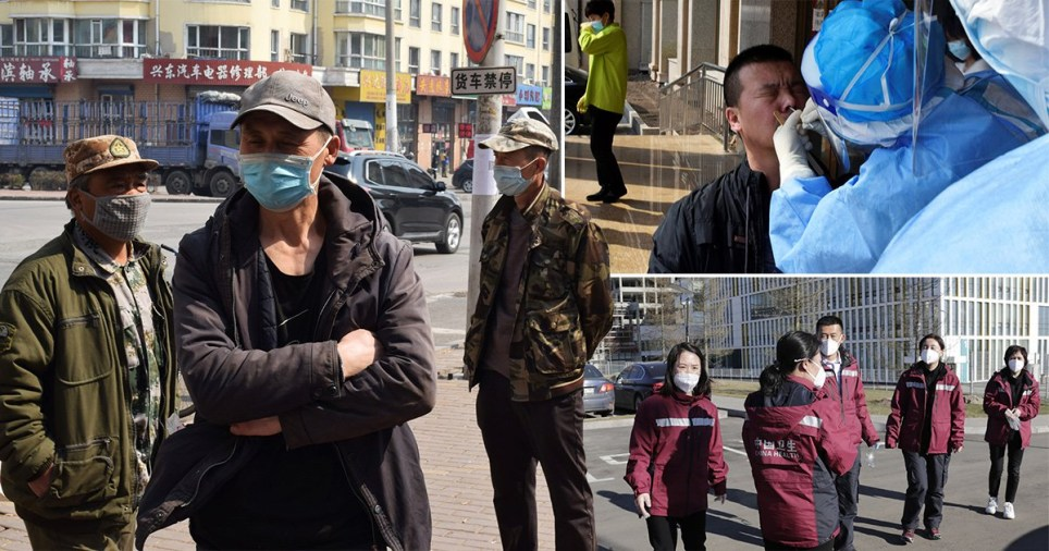Workers and medics wear face masks in the city of Suifenhe, Heilongjiang province, after a flare-up of coronavirus near the Russian border