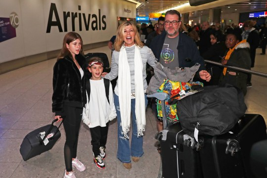 Kate Garraway, alongside her husband Derek Draper and two children Darcey, 13, and Bill, 10, arrives back at Heathrow Airport after the 2019 series of I'm A Celebrity ... Get Me Out Of Here! PA Photo. Picture date: Wednesday December 11, 2019. See PA story SHOWBIZ Celebrity. Photo credit should read: Steve Parsons/PA Wire