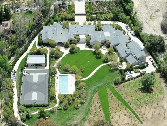 EXCLUSIVE. Coleman-Rayner Hidden Hills, CA, USA. April 7, 2019 Aerial images of Kim Kardashian and Kanye West?s Hidden Hills mansion show that the property is near completion after years of renovations. The couple has just installed a full-size basketball court as well as building a new swimming pool and adding another wing to the house. Kim and Kanye have also extended the grounds and planted dozens of trees. They purchased the property from Lisa Marie Presley in August 2014 for $20 million and finally moved in in December 2017. Kim?s mother, Kris Jenner, now lives in the house across the street. CREDIT MUST READ: Jeff Rayner/Coleman-Rayner Tel US (001) 310 474 4343 - office www.coleman-rayner.com