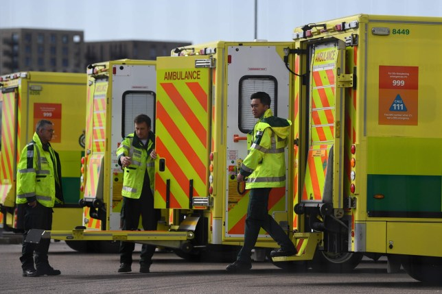 London ambulance staff members are seen with vehicles in the parking lot of the ExCeL London exhibition center in London on April 1, 2020, which was converted into an NHS Nightingale hospital to help the new COVID-19 coronavirus pandemic . - Britain reported a record daily death toll of 381 cases of coronavirus on March 31, including a 13-year-old boy, more than double the number of deaths recorded in the country in the past 24 hours. (Photo by DANIEL LEAL-OLIVAS / AFP) (Photo by DANIEL LEAL-OLIVAS / AFP via Getty Images)