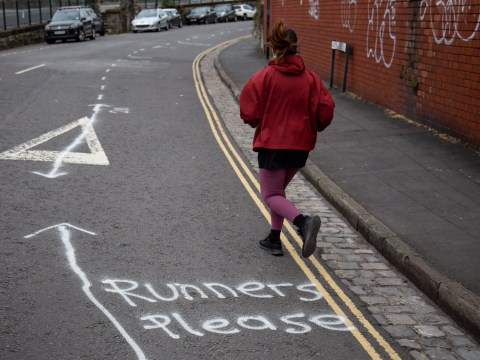 People spray paint 'running lane' on the street to ensure joggers maintain social distancing