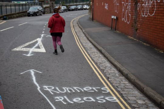A specially marked out 'runner lane' on Avon Crescent in Bristol. The 2m wide lane has been marked out to keep social distancing on a route that is popular with runners. Bristol. 01 April 2020. See SWNS story SWBRrunning.