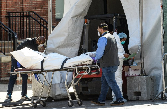 Zuma via PA Images April 6, 2020, New York Brooklyn Borough, USA: Funeral home collecting from the Hospital the body of the coronavirus victim Brooklyn Hospital Center (Credit Image: ? Marcus Santos/ZUMA Wire)