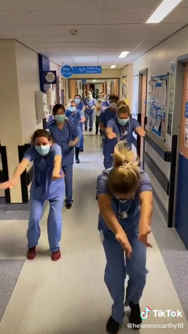 BRAVE NHS staff show spirits are still high in hospitals by performing hilarious synchronised dancing routines. Healthcare workers on the J19 ward in St James??? Hospital, Leeds. TRIANGLE NEWS 0203 176 5581 // contact@trianglenews.co.uk By Ralph Blackburn The brilliant footage shows doctors and nurses - clad in protective equipment - boogieing on the ward perfectly in sync. And the videos have gone viral, with Brits desperate to support the hardworking medical staff getting our nation through the coronavirus pandemic. *TRIANGLE NEWS DOES NOT CLAIM ANY COPYRIGHT OR LICENSE IN THE ATTACHED MATERIAL. ANY DOWNLOADING FEES CHARGED BY TRIANGLE NEWS ARE FOR TRIANGLE NEWS SERVICES ONLY, AND DO NOT, NOR ARE THEY INTENDED TO, CONVEY TO THE USER ANY COPYRIGHT OR LICENSE IN THE MATERIAL. BY PUBLISHING THIS MATERIAL , THE USER EXPRESSLY AGREES TO INDEMNIFY AND TO HOLD TRIANGLE NEWS HARMLESS FROM ANY CLAIMS, DEMANDS, OR CAUSES OF ACTION ARISING OUT OF OR CONNECTED IN ANY WAY WITH USER'S PUBLICATION OF THE MATERIAL*