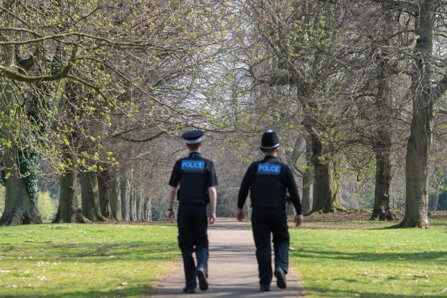 Police officers patrol a park in Northampton.
