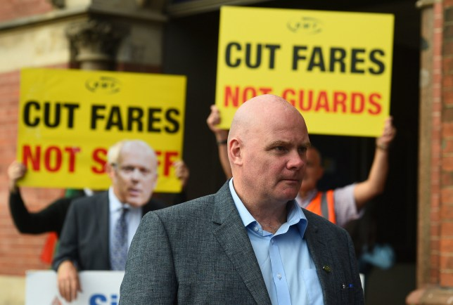Rail, Maritime and Transport union (RMT) senior assistant general secretary Steve Hedley speaks to the media during a protest over train fares outside King's Cross station in London.