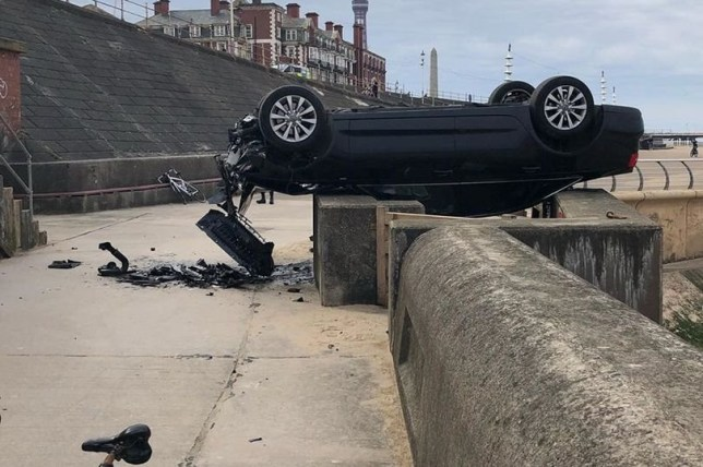 A cyclist was treated at the scene but suffered no serious injuries after a car rolled down a road in Blackpool and smashed onto the sea defences. Lancashire Constabulary and North West Ambulance Service were both called to the scene this morning (April 12) after a vehicle ended up on the lower walk.