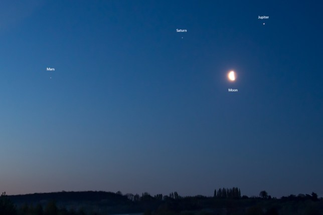 Incredible moment that the planets Mars, Saturn and Jupiter align with the moon below is captured at dawn this morning in Cobham, Kent. Pictured: Ref: SPL5162293 150420 NON-EXCLUSIVE Picture by: HowesImages / SplashNews.com Splash News and Pictures USA: +1 310-525-5808 London: +44 (0)20 8126 1009 Berlin: +49 175 3764 166 photodesk@splashnews.com World Rights,