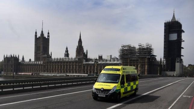 An ambulance drives over Westminster Bridge