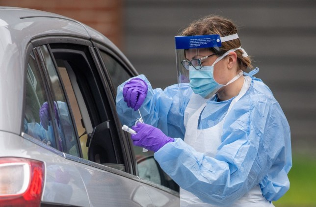 NHS staff carry out Coronavirus tests at a testing facility in Bracebridge Heath, Lincoln, as the UK continues in lockdown to help curb the spread of the coronavirus. PA Photo. Picture date: Saturday April 18, 2020. See PA story HEALTH Coronavirus. Photo credit should read: Joe Giddens/PA Wire