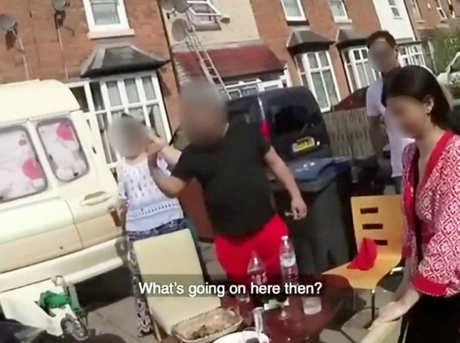 This is the moment police confronted a family for eating dinner on their driveway amid the coronavirus lockdown. See SWNS story SWMDcovidiots. The family, claiming to be from the same household, had dragged tables and chairs outside their city home to enjoy a meal in the sunshine. But the celebratory meal was soon shut down by West Midlands Police, who have been tasked with enforcing strict social distancing rules across the region. The force say they are using a 'common sense' approach to stop people flouting orders to stay at home before moving to enforcement including handing out fines. Along with the family shown in the video, police were also seen instructing two men boxing in a park to go home and a trio sat drinking outside New Street Station.