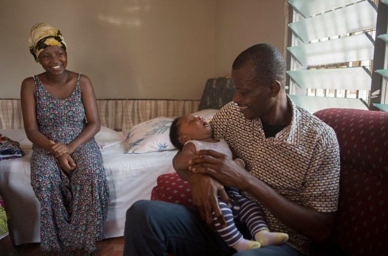 Adams Zakari at home with his Wife Mariana Mohammed and Son, King, before heading off to work, spraying houses with insecticide to prevent Malaria. 27/2/20.Photo Tom Pilston