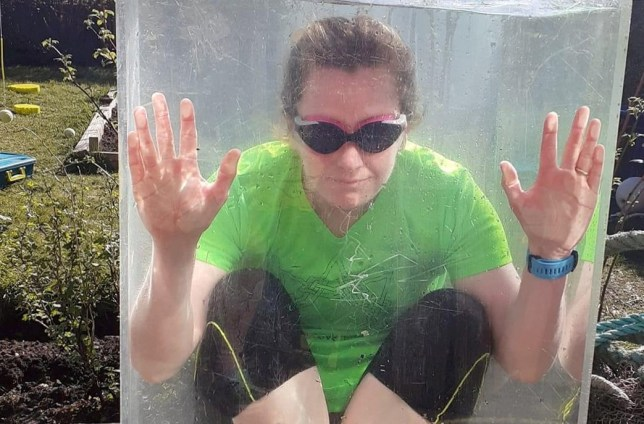 This bizarre photo shows wild swimmer Elspeth Murphy training her cold water tolerance during the lockdown - by sitting in a 300 litre tank filled with freezing water in her garden. See SWNS story SWSCswimmer. A wild swimmer has been compensating for not being allowed a dip in the sea during lockdown - by sitting in a 300 litre tank filled with cold water in her garden. Elspeth Murphy, 45, normally goes wild swimming around the Isle of Lewis, Outer Hebrides but had to stop after the Coastguard and RNLI warned against doing the activity during the coronavirus pandemic. She got into the pastime with the help of friend Norma MacLeod, who runs her own wild swimming business, Immerse Hebrides. But with the sea a no-go area, Norma encouraged swimmers to maintain their cold water tolerance by taking part in a 30-day cold water challenge.