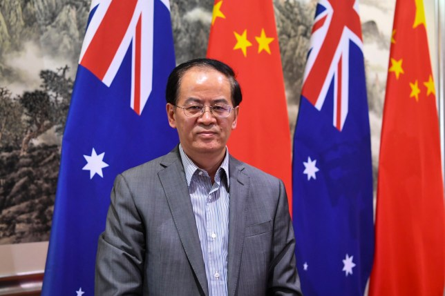 Chinese Ambassador to Australia Cheng Jingye poses for photographs after holding a press conference at the Ambassador's residence in Canberra, Thursday, December 19, 2019. (AAP Image/Lukas Coch) NO ARCHIVING
