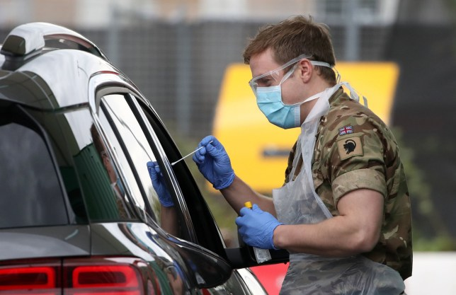 A soldier from 2 Scots Royal Regiment of Scotland assists at a Covid-19 testing centre at Glasgow Airport, as the UK continues in lockdown to help curb the spread of the coronavirus. PA Photo. Picture date: Wednesday April 29, 2020. See PA story HEALTH Coronavirus. Photo credit should read: Andrew Milligan/PA Wire