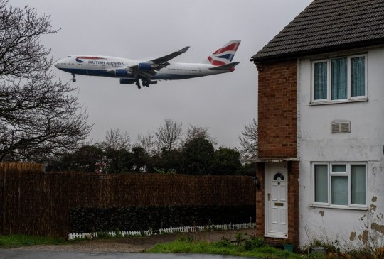 LONDON, ENGLAND - FEBRUARY 27: Aircraft come in to land at Heathrow airport over nearby houses on February 27, 2020 in London, England. Plans for a third runway at Heathrow airport have been ruled illegal by the court of appeal because it is said that the government's climate change commitments were not adequately taken into account. The UK government will not appeal the decision whilst they have set a target in law of net zero emissions by 2050. (Photo by Chris J Ratcliffe/Getty Images)