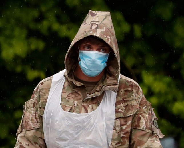A soldier of the Royal Welsh regiment tests people for coronavirus