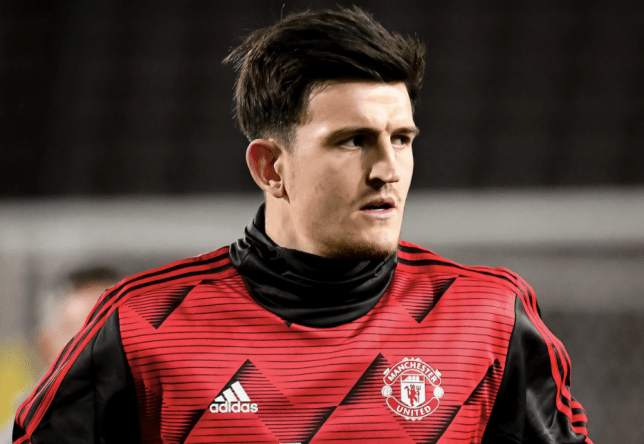Harry Maguire looks on in warm-up ahead of Manchester United clash