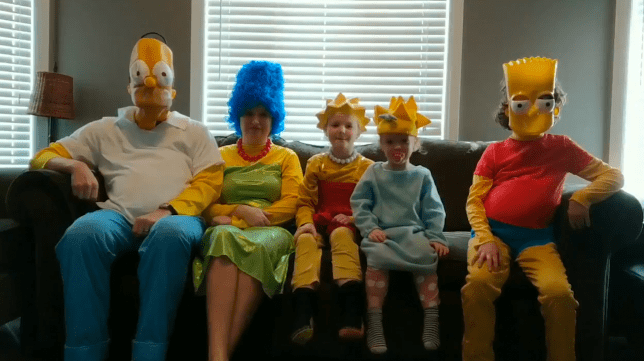 Joel Sutherland and his family dressed as The Simpsons sat on the sofa