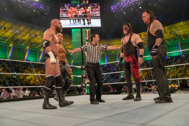D-Generation X (Shaw Michaels and Triple H) against The Brothers of Destruction (Kane and The Undertaker) and Crown Jewel