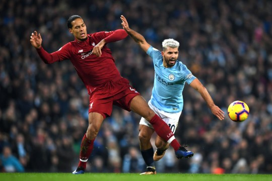 Virgil van Dijk and Sergio Aguero challenge for the ball in Liverpool's clash with Manchester City