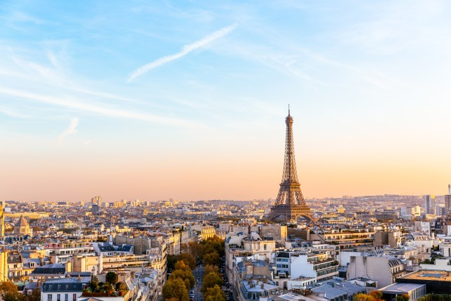 Paris cityscape with Eiffel Tower at sunset.