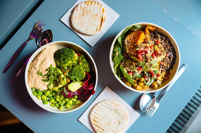 Vegan bowls with various vegetables and seeds