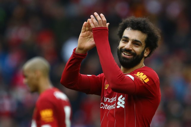 Mohamed Salah smiles after a Liverpool game